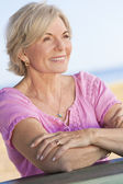 Happy Attractive Senior Woman Sitting Outside — Stock Photo