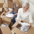 Female Generations of Family Unpacking Boxes Moving House — Stock Photo
