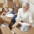 Female Generations of Family Unpacking Boxes Moving House — Stock Photo #6285773