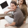 Man & Woman Couple Using Laptop Computer At Home — Stock Photo #6287795