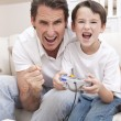 Happy Man & Boy, Father and Son Playing Video Games — Stock Photo