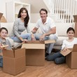 Family Unpacking Boxes Moving House — Stock Photo #6287814
