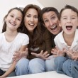 Happy Family Having Fun Sitting Laughing At Home — Stock Photo #6287815