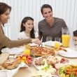 Parents Children Family Eating Pizza &amp; Salad At Dining Table - Stock Photo