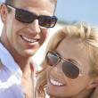 Royalty-Free Stock Photo: Happy Attractive Woman and Man Couple In Sunglasses At Beach