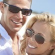 Stock Photo: Happy Attractive Woman and Man Couple In Sunglasses At Beach