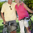 Happy Senior Couple on Bicycles In Green Park — Stock Photo