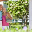 Happy Senior Couple Smiling Outside in Sunshine - Stock Photo