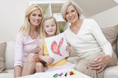 Mother Daughter Grandmother Generations at Home wih Heart Picture — Stock Photo