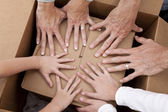 Family Hands Unpacking Boxes Moving House — Stock Photo
