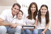 Happy Family Having Fun Using Tablet Computer At Home — Stock Photo