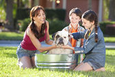 Mother Son & Daughter Family Washing Pet Dog In A Tub — 图库照片