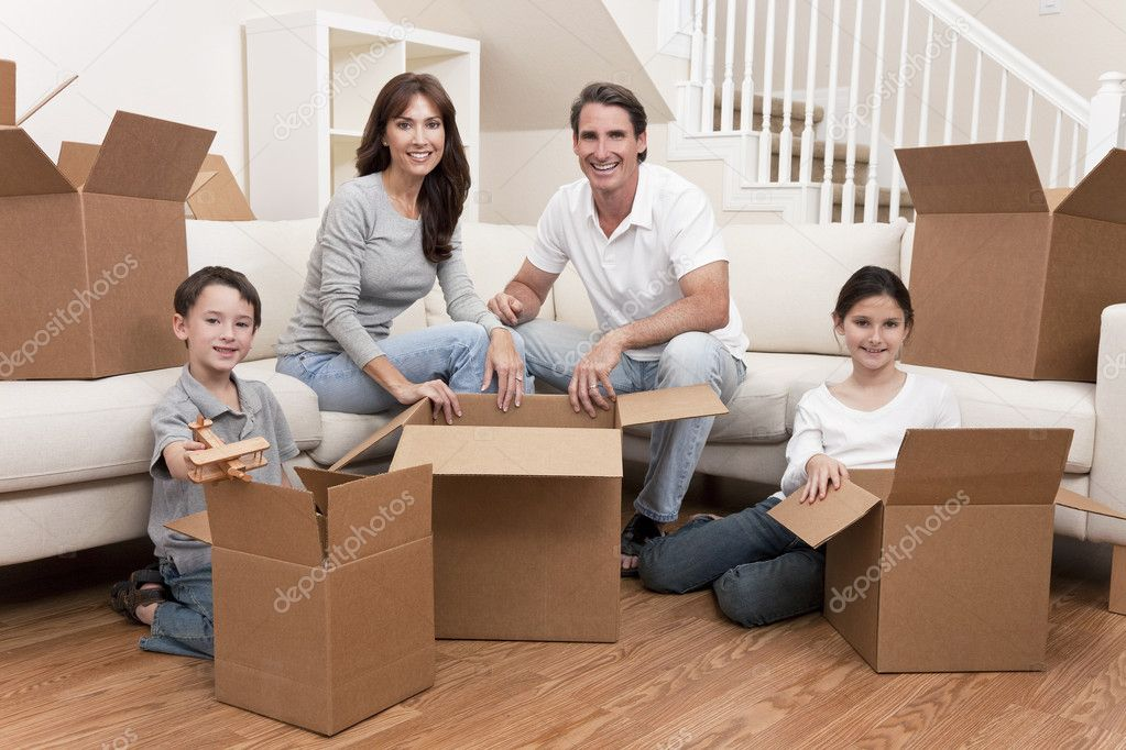 Family, parents, son and daughter, unpacking boxes and moving into a new home. — Stock Photo #6287814