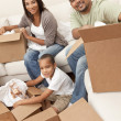 African American Family Unpacking Boxes Moving House — Stock Photo