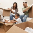 African American Family Unpacking Boxes Moving House - Foto de Stock