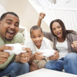African American Family Having Fun Playing Computer Console Game — Stock Photo