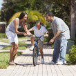 African American Family WIth Boy Riding Bike & Happy Parents — Stock Photo