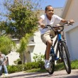 African American Family WIth Boy Riding Bike & Happy Parents — Stock Photo #6318642