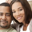 Royalty-Free Stock Photo: Happy African American Couple Sitting At Home