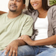 Stock Photo: Happy African American Couple Sitting At Home