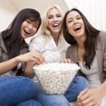 Three Beautiful Women Friends Eating Popcorn Watching Movie at H — Stock Photo