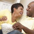Happy African American Couple Eating Popcorn Watching Movie at H — Stock Photo