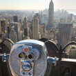 Manhattan Skyline And Tourist Binoculars New York City - Stock Photo