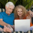 Senior Man and Woman Couple Outside Using Laptop Computer — Stock Photo