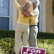 Senior Man and Woman Couple Viewing A House For Sale — Stock Photo