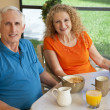 Senior Man and Woman Couple Enjoying a Healthy Breakfast — Stockfoto