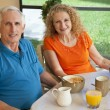 Senior Man and Woman Couple Enjoying a Healthy Breakfast - Stock Photo
