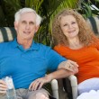 Senior Man & Woman Couple Enjoying Retirement Drinks on Vacation — Stock Photo