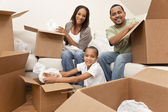 African American Family Unpacking Boxes Moving House — Stock fotografie