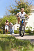 African American Family WIth Boy Riding Bike & Happy Parents — Foto Stock