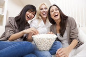 Three Beautiful Women Friends Eating Popcorn Watching Movie at H — Stock Photo