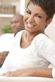 Happy African American Woman Couple Sitting At Home — Stock Photo