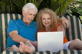 Senior Man and Woman Couple Outside Using Laptop Computer — Stock Photo