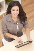 Happy Beautiful Young Woman Using Tablet Computer at Home — Stock Photo