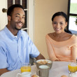 Happy African American Couple Eating Healthy Breakfast — Stock Photo #6469695
