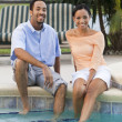 Happy African American Couple Sitting With Feet In Swimming Pool — Stock Photo