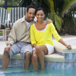 Happy African American Couple Sitting Outside Next To Swimming P — Stock Photo