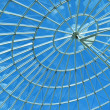 Blue Sky Through a Modern Architecture Round Spiral Window. — Stock Photo