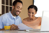 Happy African American Couple With Laptop Computer & Paperwork — Foto Stock