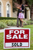 African American Couple Celebrating House Purchase For Sale Sign — Stock Photo