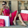Beautiful Latin Woman In Red Dress With Shopping Bags — Stockfoto