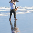 Man and Woman Couple Having In Romantic Embrace On Beach — Stock Photo #6470044