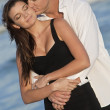 Man and Woman Couple Kissing In Romantic Embrace On Beach - Foto de Stock  
