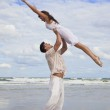 Yong Man and Woman Couple, Jumping in Celebration On Beach — Stock Photo #6470064