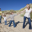 Mother, Father and Two Boys Holding Hands At Beach — Stock Photo