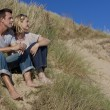 Romantic Man and Woman Couple Sitting Together On A Beach — Stock Photo